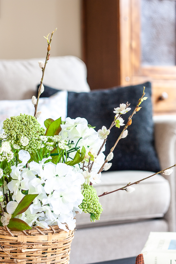 Faux flower arrangement for spring on a coffee table