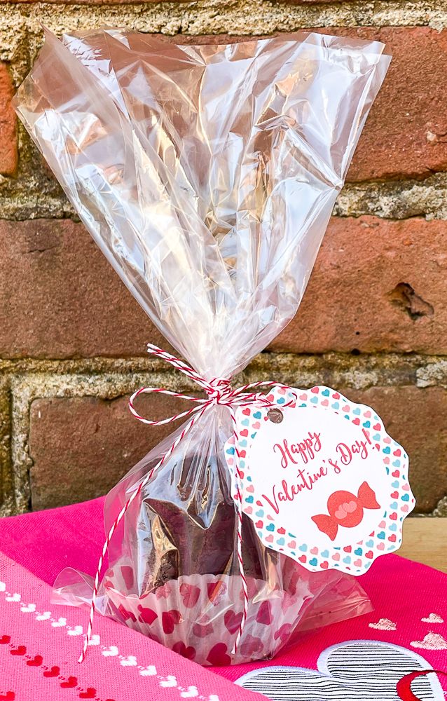 Triple Chocolate Brownies packaged in a clear bag with a heart embellished cupcake holder.