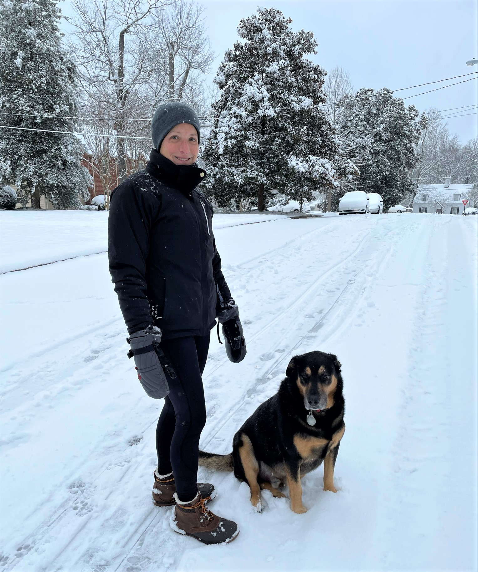 Woman and dog in the snow