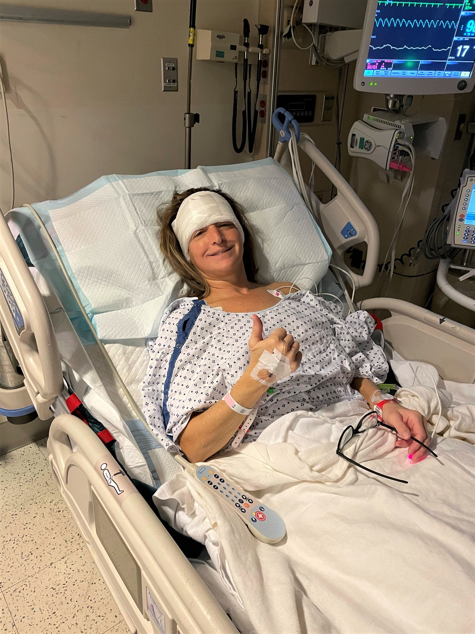 Woman in hospital bed post craniotomy