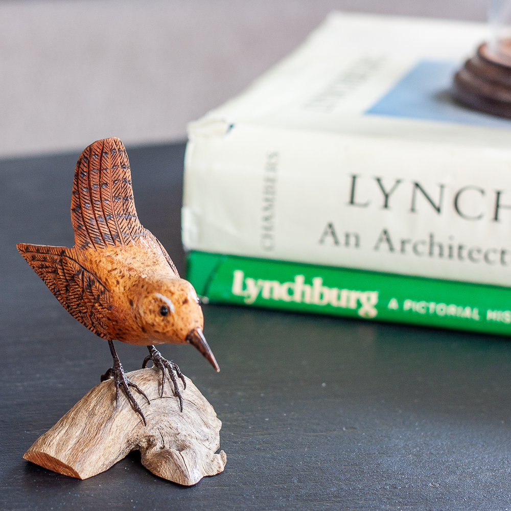 Hand carved bird displayed with S. Allen Chambers Lynchburg an Architectural History book and Lynchburg, A Pictorial History Book