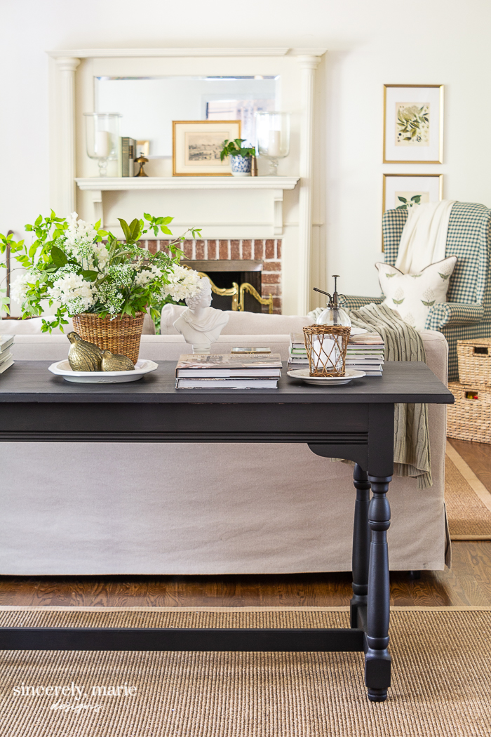 Black console table decorated for spring