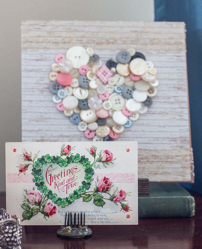 Early 1900s Valentine's Day postcard with a heart made with vintage buttons