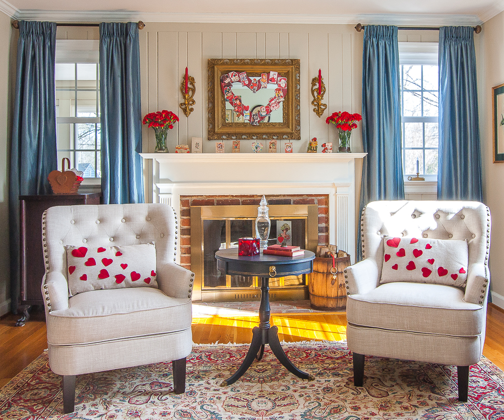 Living room decorated with vintage Valentine's Day decor pieces including the mantel
