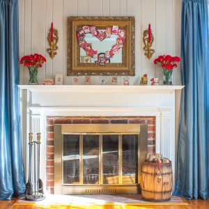 Mantel decorated for Valentine's Day with vintage Valentine's Day cards