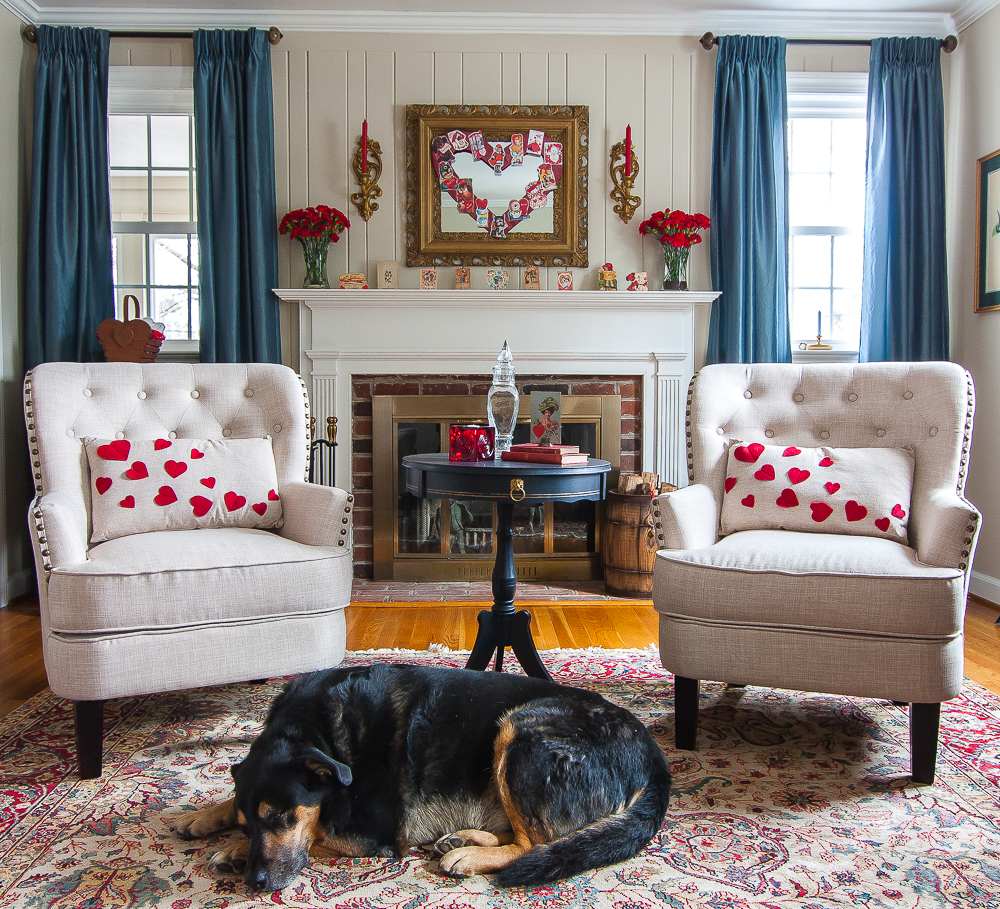 Dog on a rug in a living room decorated for Valentine's Day with Vintage