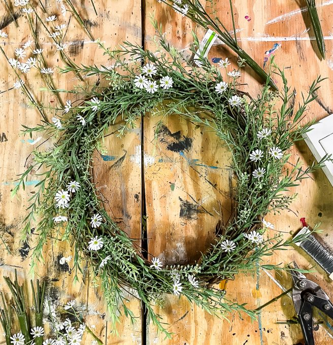 Daisies and greenery on a grapevine wreath