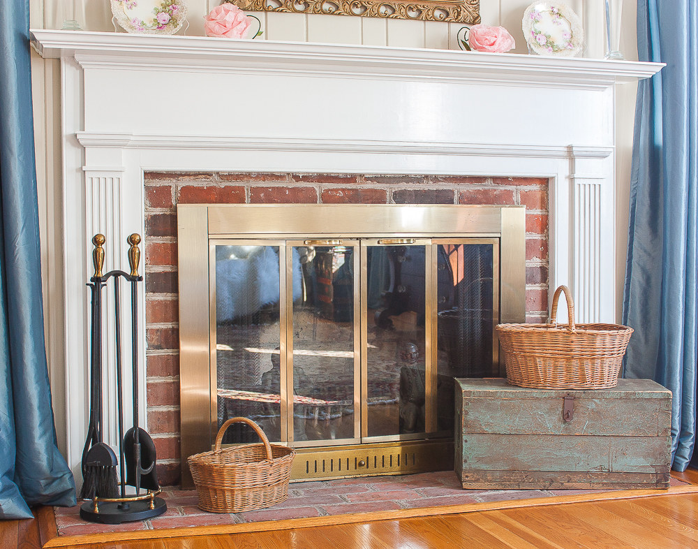 Fireplace hearth decorated with a vintage toolbox and baskets made by Charles M. Phleeger of Middletown, Maryland