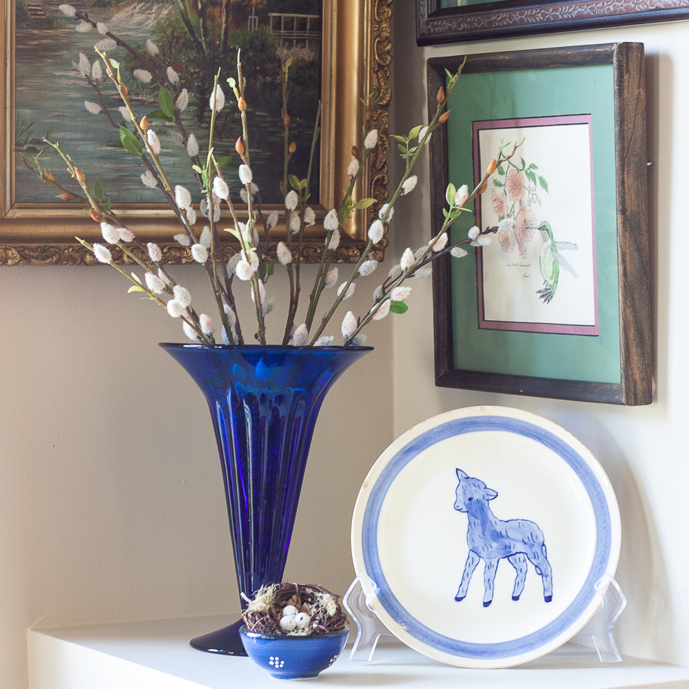 Vintage cobalt blue vase filled with pussy willow, vintage Blue Ridge Pottery lamp plate, nest in a Greek pottery bowl