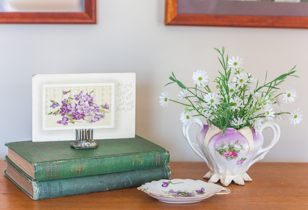 Vintage Rossetti SPRING VIOLETS Occupied Japan Leaf dish 1945-1953 with RS Prussia sugar bowl and two antique books with an antique postcard with violets