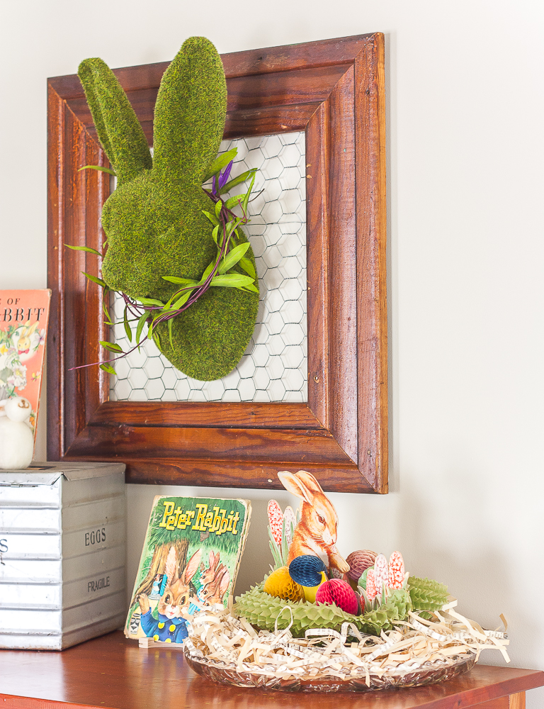 Moss covered rabbit head on a frame backed with chicken wire and other vintage Easter decorations