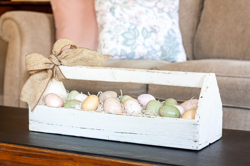 Pink, green brown speckled eggs displayed in a vintage toolbox