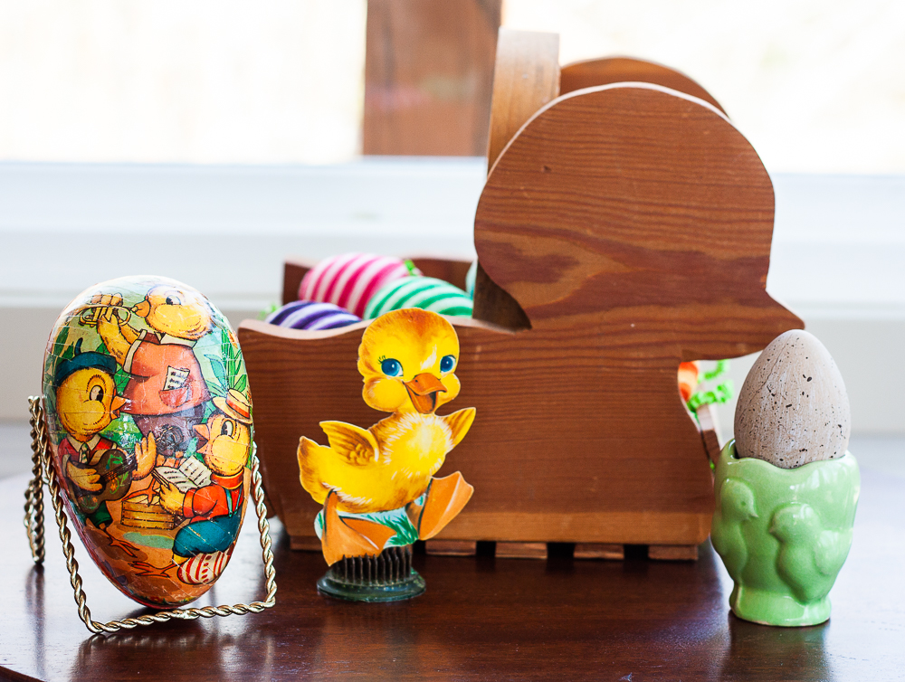 Easter vignette with wood chick basket, 1970s paper egg decorated with chicks, antique green egg cup