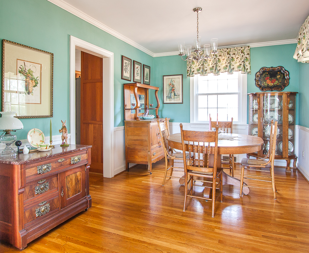 Antique filled dining room decorated for spring