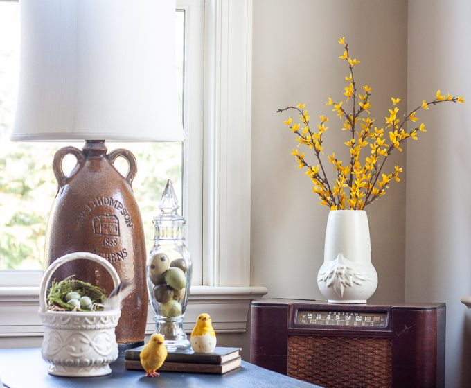 Forsythia in a white pottery vase, Hull USA basket pottery filled with a nest, chicks, eggs in a vintage glass lidded candy jar