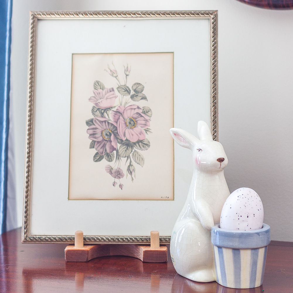 Vintage botanical framed print with an Easter bunny figurine