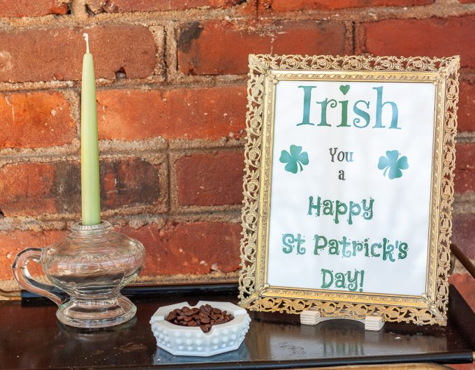 Irish you a happy st. patrick's day free printable, milk glass ashtray filled with coffee beans, antique lamp used as a candle holder