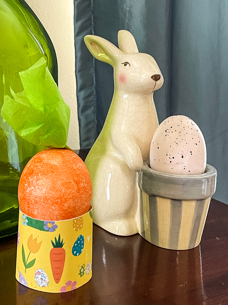 Yellow Free Printable Easter Egg Holder with an Easter Egg Decorated to Look Like a Carrot