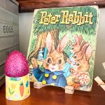 1961 Peter Rabbit book with glittered egg in a paper egg holder