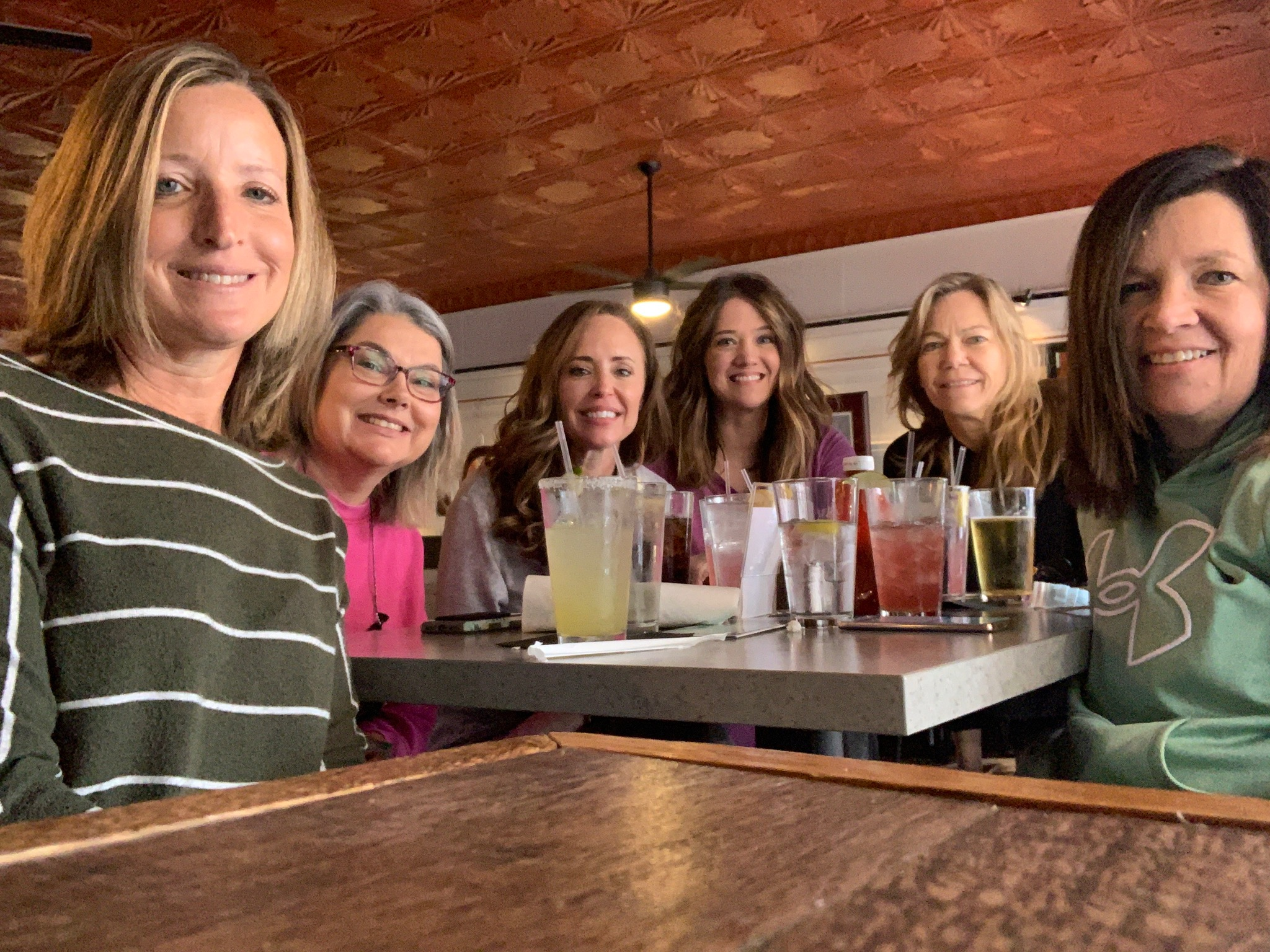 Six women at a table with cocktails in Fredericksburg, VA