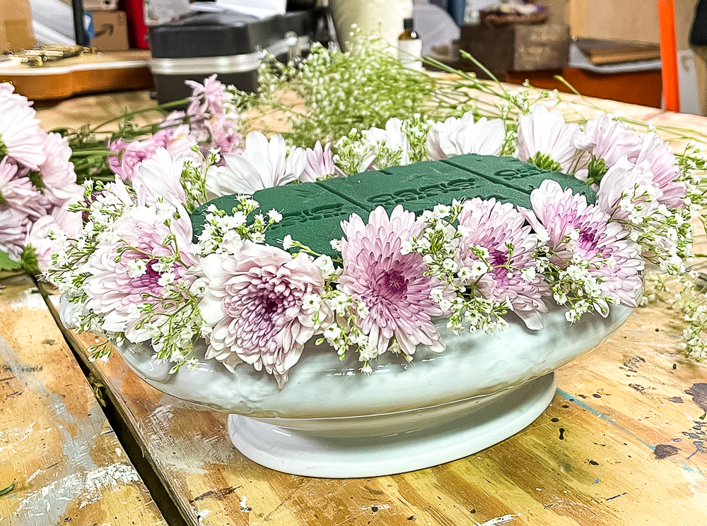 Making a purple Chrysanthemum and Baby's Breath floral arrangement