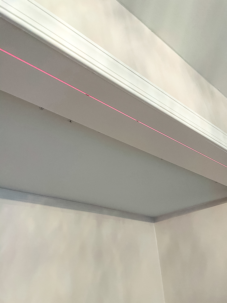 Using a laser level to mark placement of bifold closet door tracks