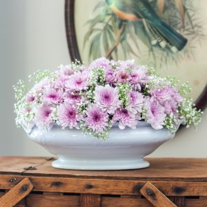 Light purple Chrysanthemums and Baby's Breath floral arrangement in an Ironstone bowl