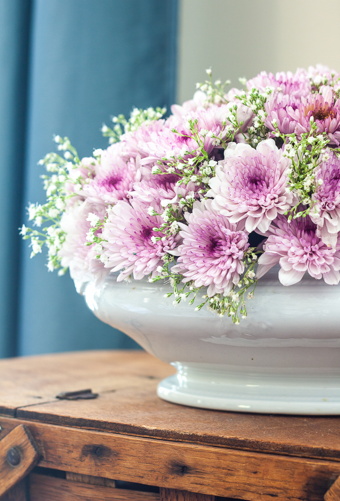 Purple Chrysanthemums and Baby's Breath floral arrangement in an Ironstone bowl