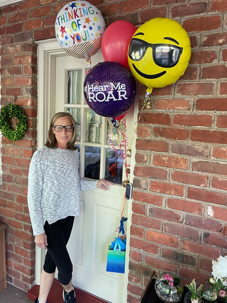 Balloons tied to a dutch door