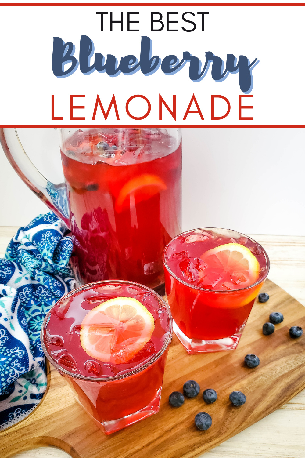 Homemade blueberry lemonade served in a pitcher with two poured glasses garnished with a lemon slice and blueberries