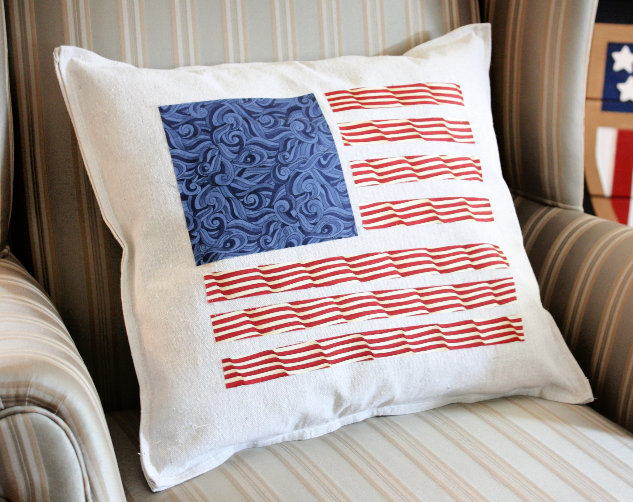 American flag pillow made with strips of fabric.