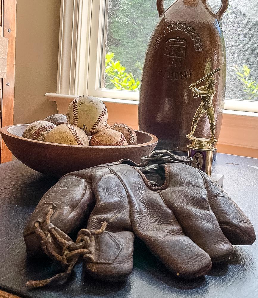 1920'S GOLDSMITH BASEBALL GLOVE, 1970s baseball trophy, and bowl of baseballs