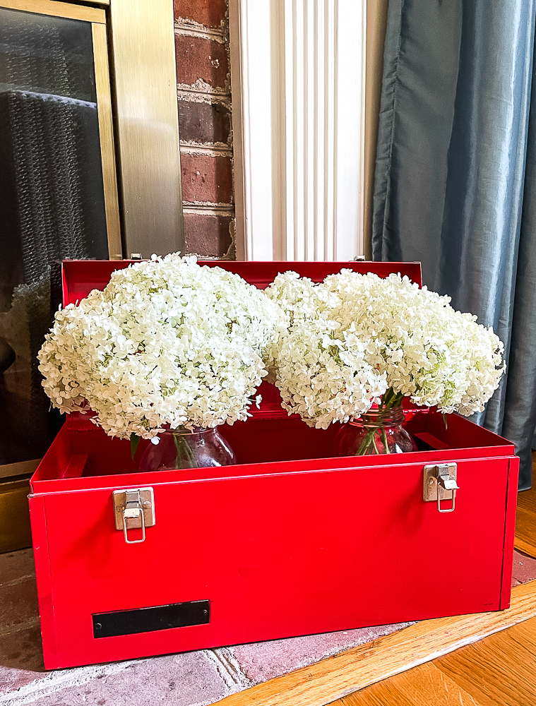 red toolbox filled with hydrangea