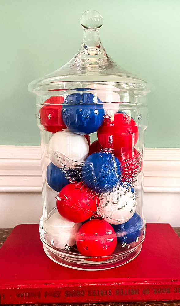 painted ping pong balls in a glass jar