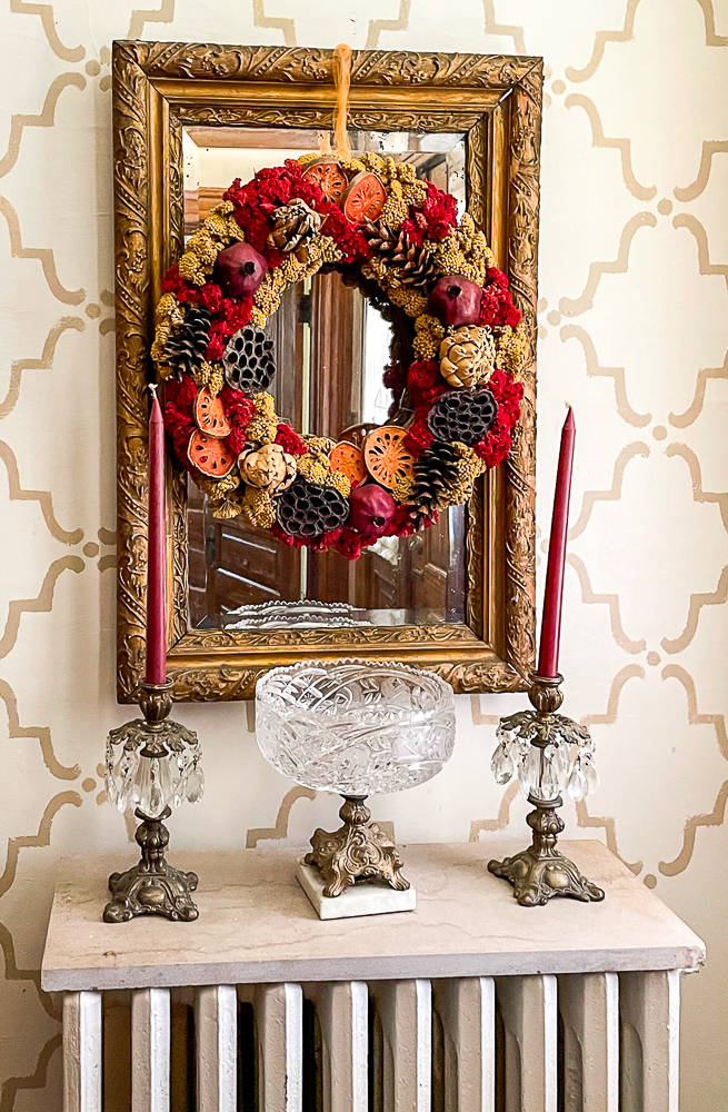 Antique Gold Mirror with a Williamsburg Style Wreath_
