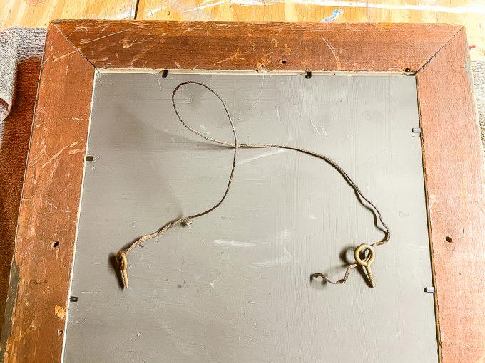 Old hanger on antique mirror