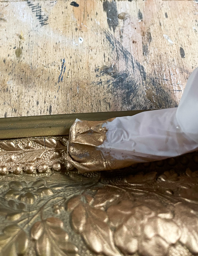 Applying Rub 'n Buff to an antique mirror frame