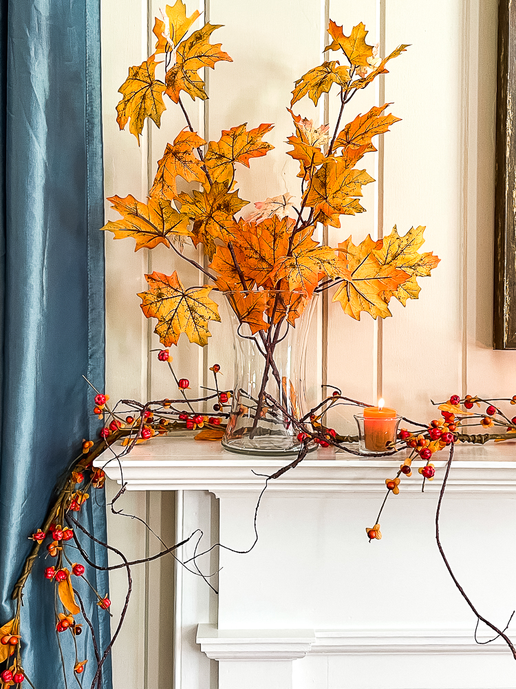 Fall mantel decorated in traditional fall colors