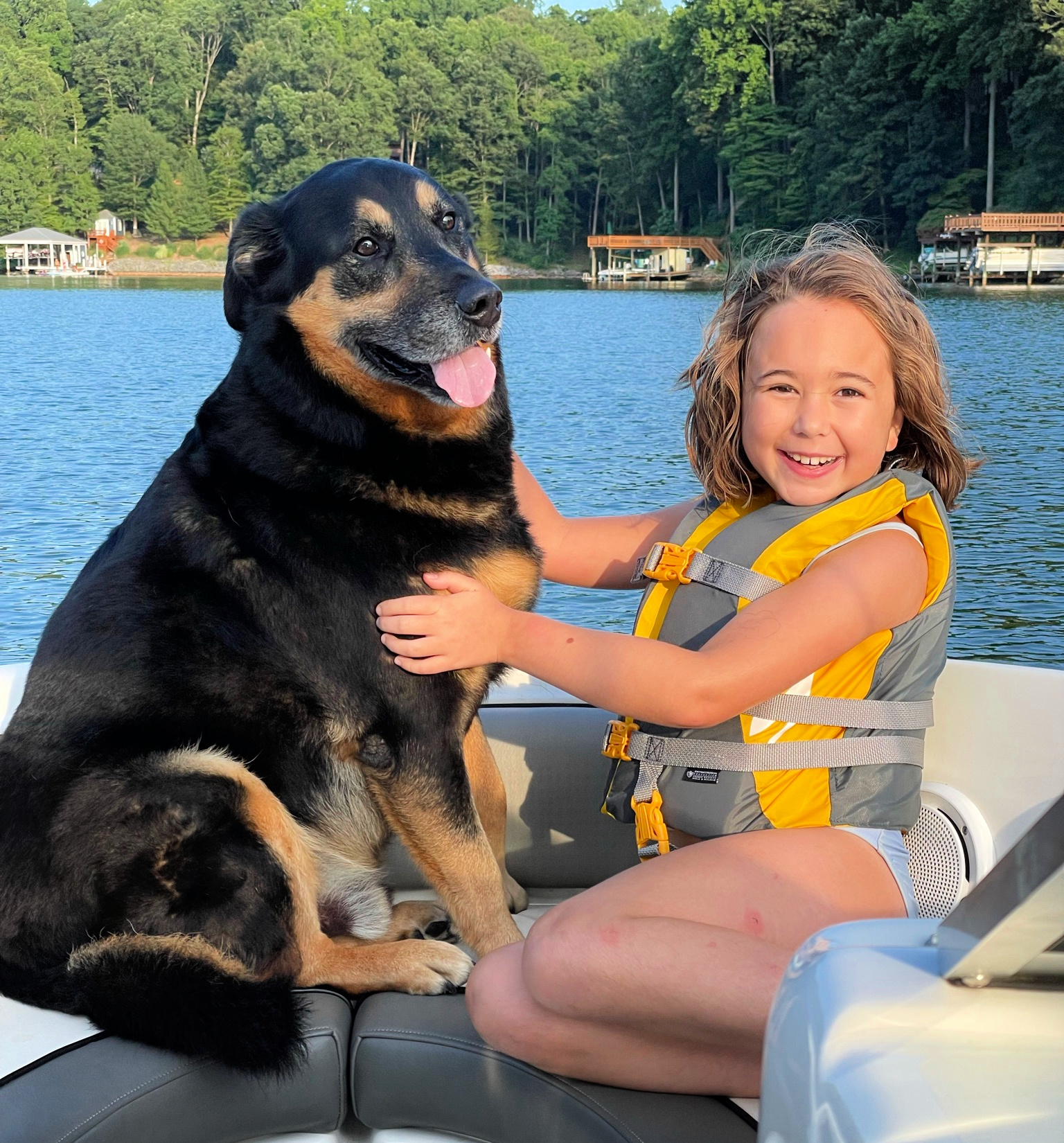Child and dog on a boat at Smith Mountain Lake, VA