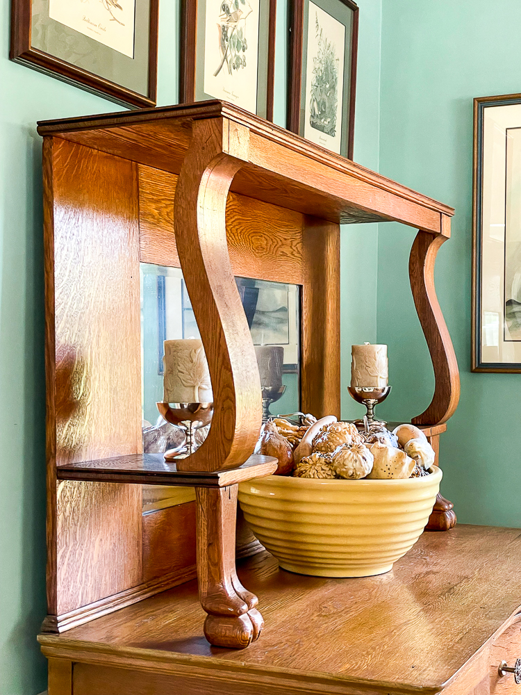 Antique oak buffet decorated for fall