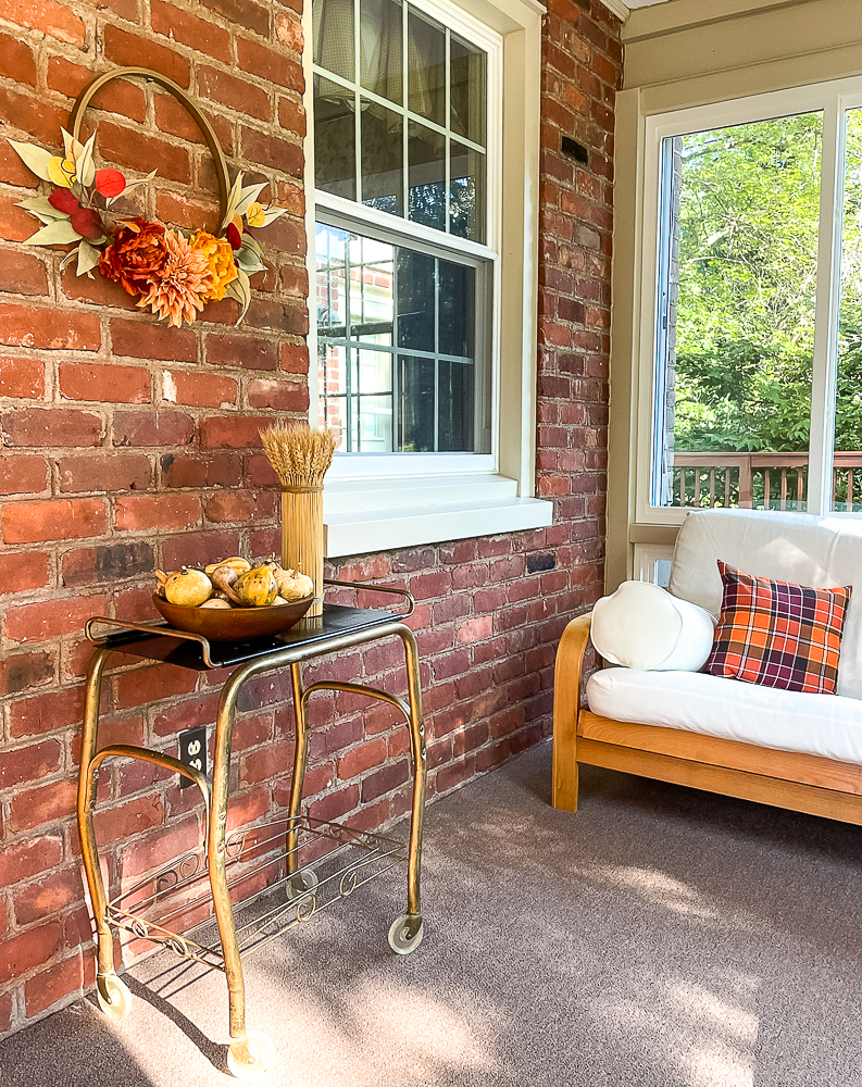 Sunroom decorated for Fall