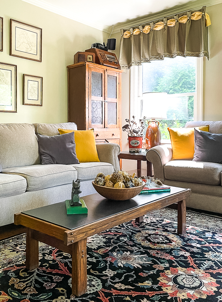 Family room decorated for fall in traditional colors