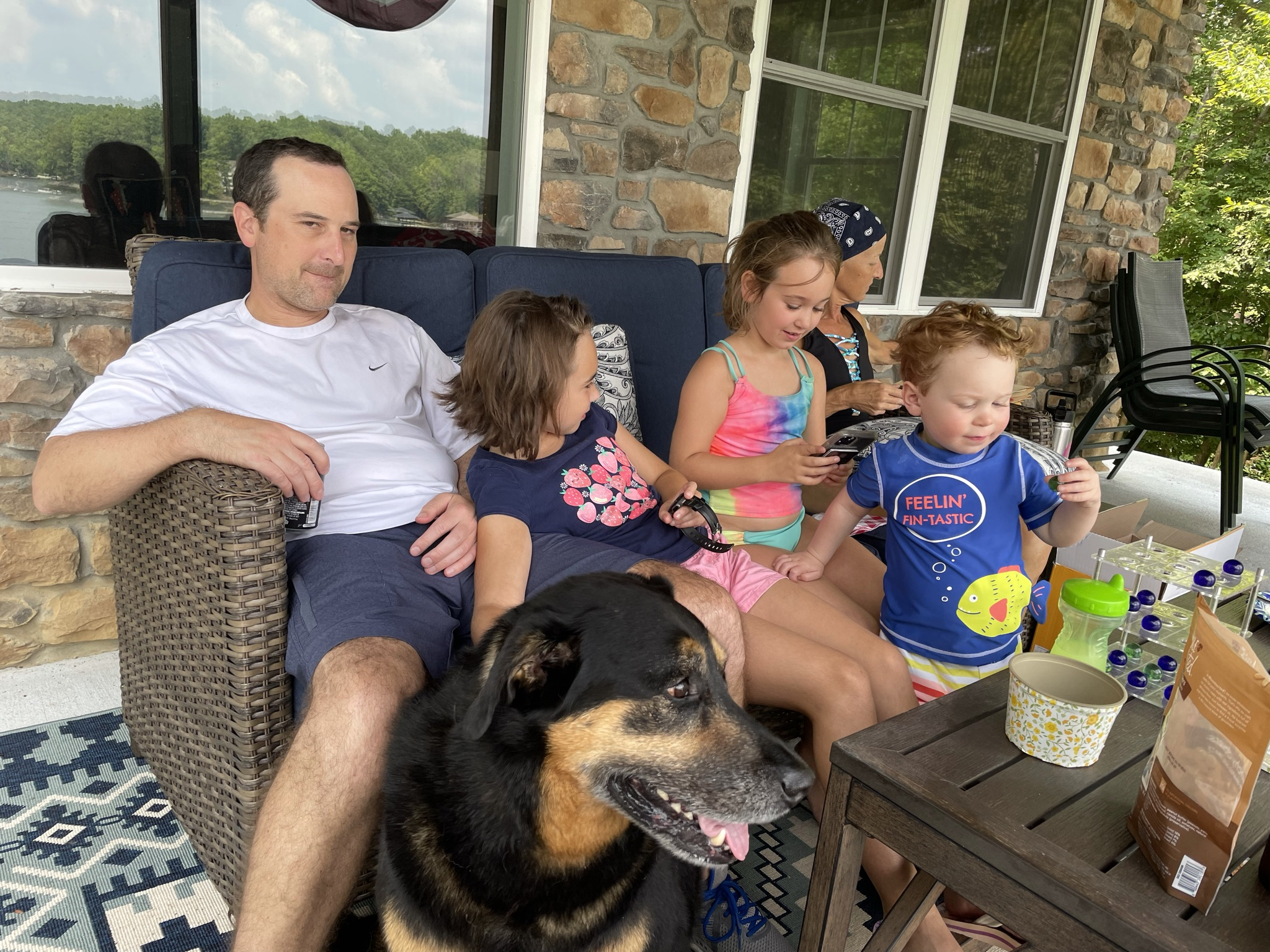 Family relaxing on a lakeside patio