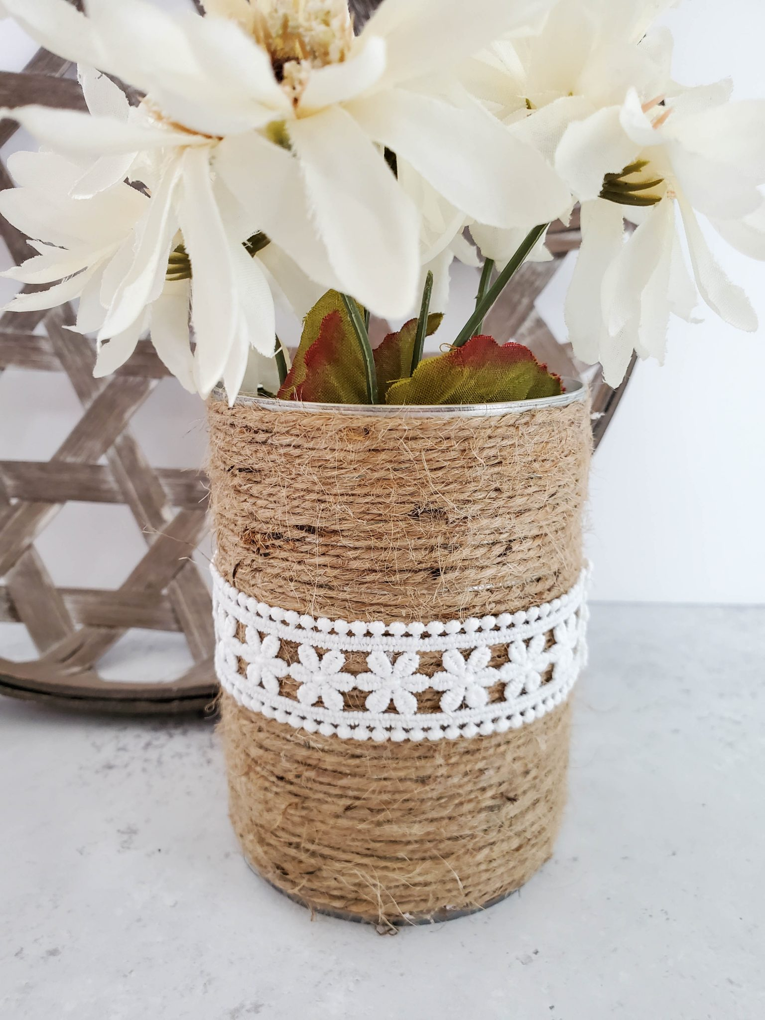 Upcycled can decorated with twine and lace