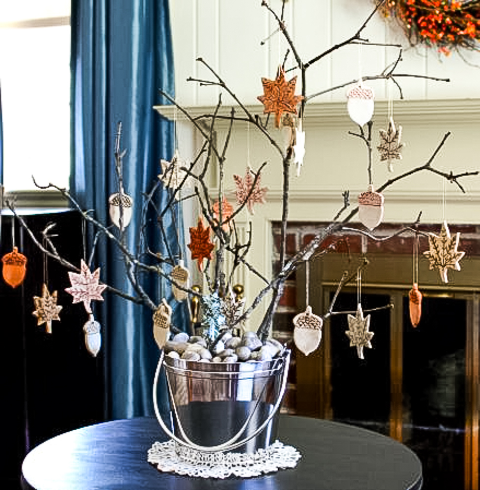 Fall Ornaments from Clay hanging on a tree branches in a silver ice bucket