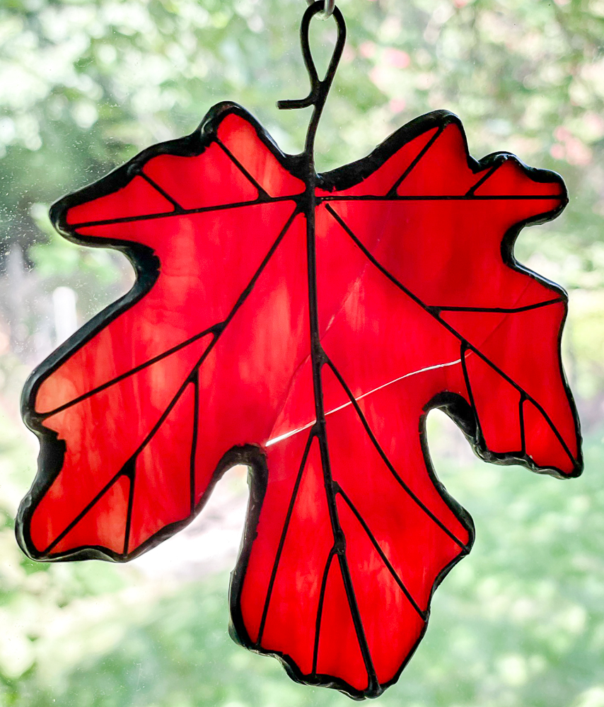 Stained glass red maple leaf suncatcher