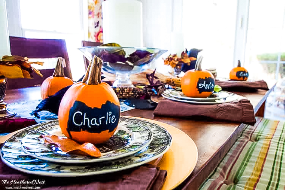 Pumpkins with chalkboard paint used as place cards