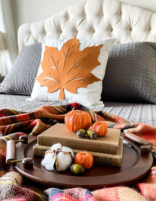 Fall vignette on a bed