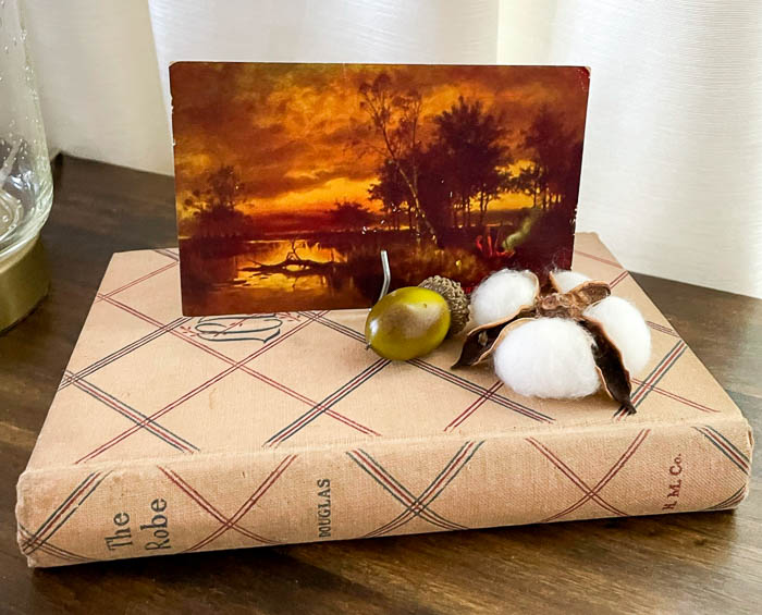 Vintage fall postcard, book cotton boll, and acorn