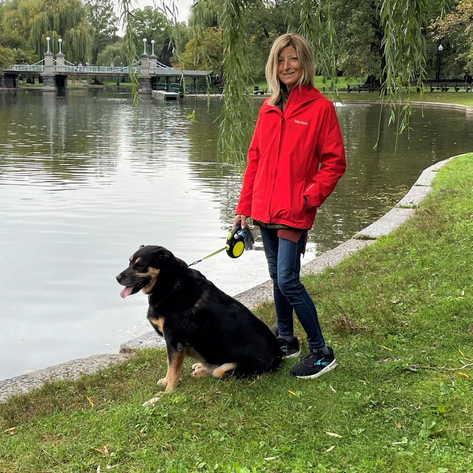Woman and dog walking in a park in Boston